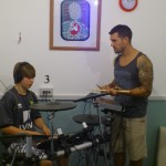 Lee Tallowin helping a student with his drum solo at Rock camp2013